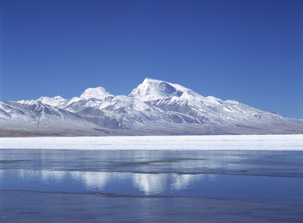 Looking across a partially frozen Lake Manasarovar to Mt Memo Nani, Tibet. © Ian Cumming / Tibet Images
